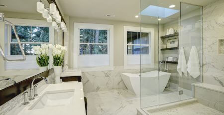 white and grey marble master bathroom with large glass walk-in shower