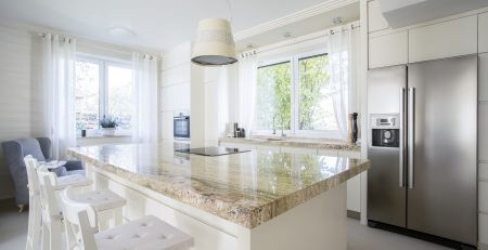 stone kitchen island in a modern kitchen