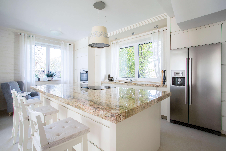 stone kitchen island in a modern kitchen