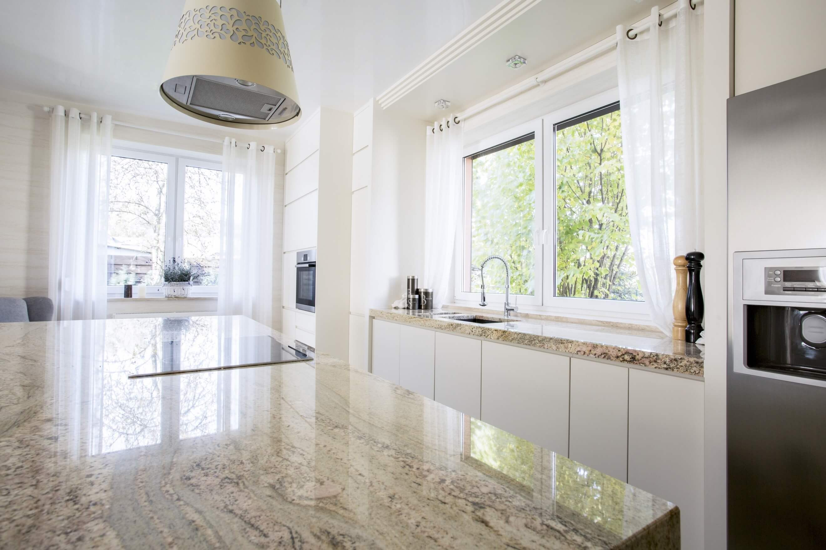 light shining off a stone kitchen worktop