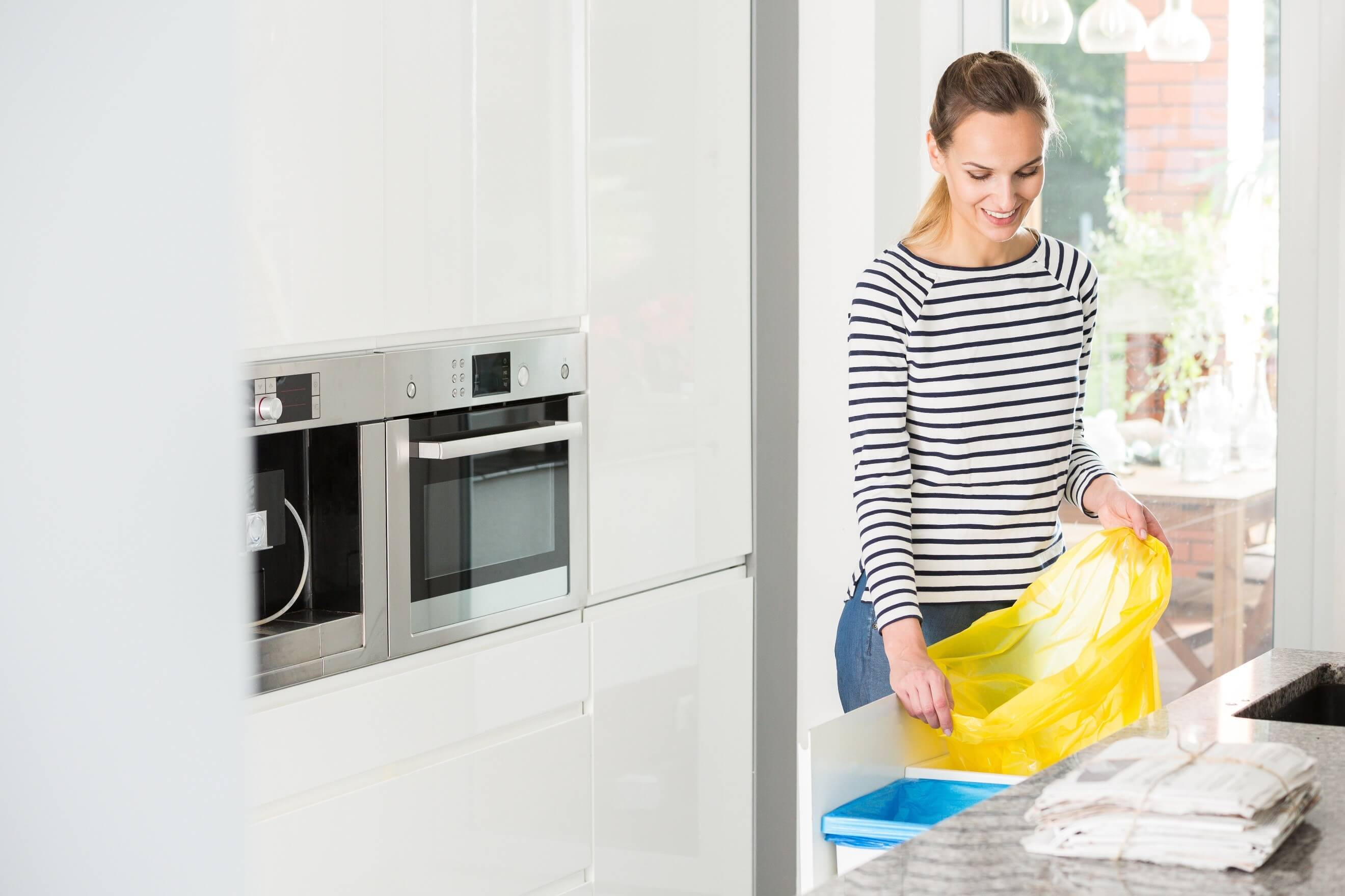 separate bins for recycling in the kitchen
